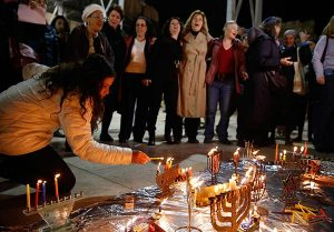 Last year, Women of the Wall, a feminist prayer group, defied a directive by the rabbi of the Western Wall banning women from lighting Hanukkah candles in the women's section of the Western Wall. Israel's deputy attorney general now says that women must be permitted to do so. (Religion News Service/Ricki Rosen)