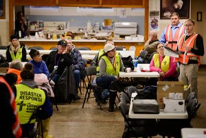 Stephen Born (far right), regional disaster-response coordinator for the LCMS Central Illinois District (CID), addresses volunteers before a cleanup event of flood-damaged homes Jan. 9 at Calvary Lutheran Church in Watseka, Ill. LCMS Disaster Response certified Born as a Lutheran Early Response Team trainer in 2014, and he, in turn, helped train hundreds of other CID responders. (LCMS/Erik M. Lunsford)