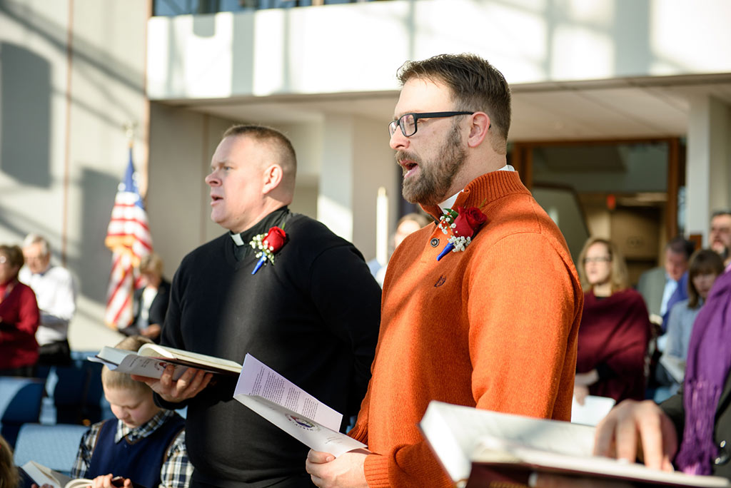 "From left, the Rev. Peter Burfeind and the Rev. Adam DeGroot, new national missionaries through ""Mission Field: USA,"" worship during a Service of Sending for them Jan. 12 at the LCMS International Center. (LCMS/Frank Kohn)"