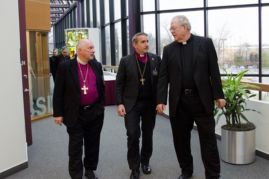 From left, Bishop Ray Sutton and Archbishop Foley Beach of the Anglican Church in North America and the Rev. Larry Vogel of the LCMS visit during a break in the Feb. 8-9 session of ongoing discussions involving their church bodies and Lutheran Church—Canada. (LCMS/Frank Kohn)
