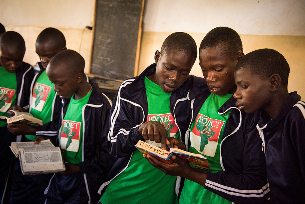 Young men read during Bible study at the Othoro ELCK (Evangelical Lutheran Church in Kenya) Project 24 boarding facility on Oct. 18, 2015, in Kisumu, Kenya. (LCMS/Erik M. Lunsford)