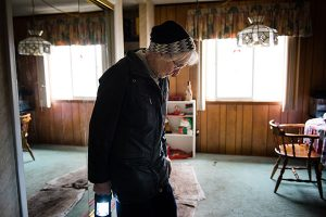 Parishioner Barb Neels of Our Savior Lutheran Church in Fenton, Mo., walks through her flood-ravaged Fenton home Jan. 7. Floodwaters overtook several communities surrounding St. Louis following intense rainstorms throughout the Midwest in late December. Neels' basement was completely submerged after floodwater breached a wall of sandbags. (LCMS/Erik M. Lunsford)