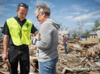 The Rev. Brian Bucklew, pastor at Zion Lutheran Church, prays with Lori Bueber on Tuesday, May 12, 2015, in Delmont, S.D. A tornado swept through the area on Sunday and destroyed the church where Bucklew is pastor along with nearby buildings in the surrounding neighborhoods. LCMS Communications/Erik M. Lunsford