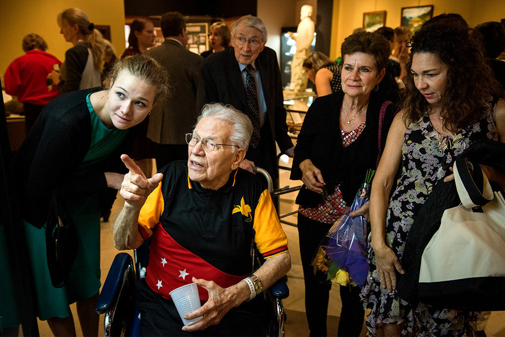 """The Rev. Dr. Otto C. Hintze Jr. browses artifacts with family, including his granddaughter, Ellie Hintze (left), during the Oct. 5, 2014, opening of Concordia Historical Institute's """"Bringing Christ to the Highlands"""" exhibit. (LCMS/Erik M. Lunsford)"""