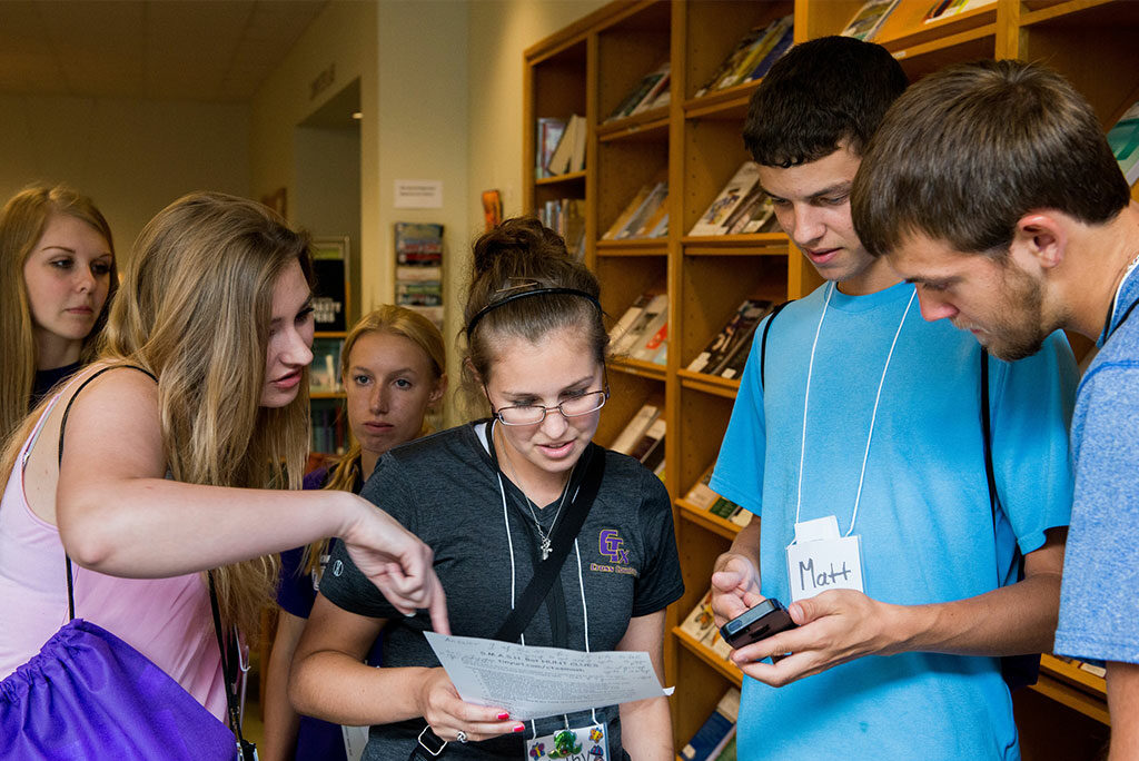 Students take part in a group activity in the library of Concordia University Texas, Austin, on July 15, 2014. A $49,760 grant from the Network for Vocation in Undergraduate Education will be used by the school to enhance its Center for Vocation & Professional Development. (LCMS/Erik M. Lunsford)