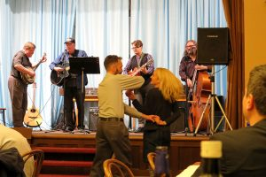 LCMS Eurasia Region Business Manager Richard Sovitzky and his wife, Sarah, dance to bluegrass music at the dinner party hosted by the LCMS Eurasia Region for the Feb. 12-14 Network of Young Lutheran Theologians conference near Prague. Playing the banjo, at left, is LCMS Eurasia Region Director Rev. James Krikava. (Craig Donofrio)