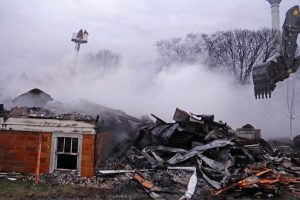 Smoke rises from the fire that was discovered just after 2 a.m. March 30 as daylight illuminates the damage to St. James Evangelical Lutheran Church in Northrop, Minn. (Courtesy of The Truman Tribune)
