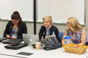 Concordia University, St. Paul students, from left, Rebecca Rust, Alexandra Van Guilder and Lydia Hook do some last-minute polishing before their presentation that earned third place in the LCEF marketing competition. (LCEF/Jay T Garrott)