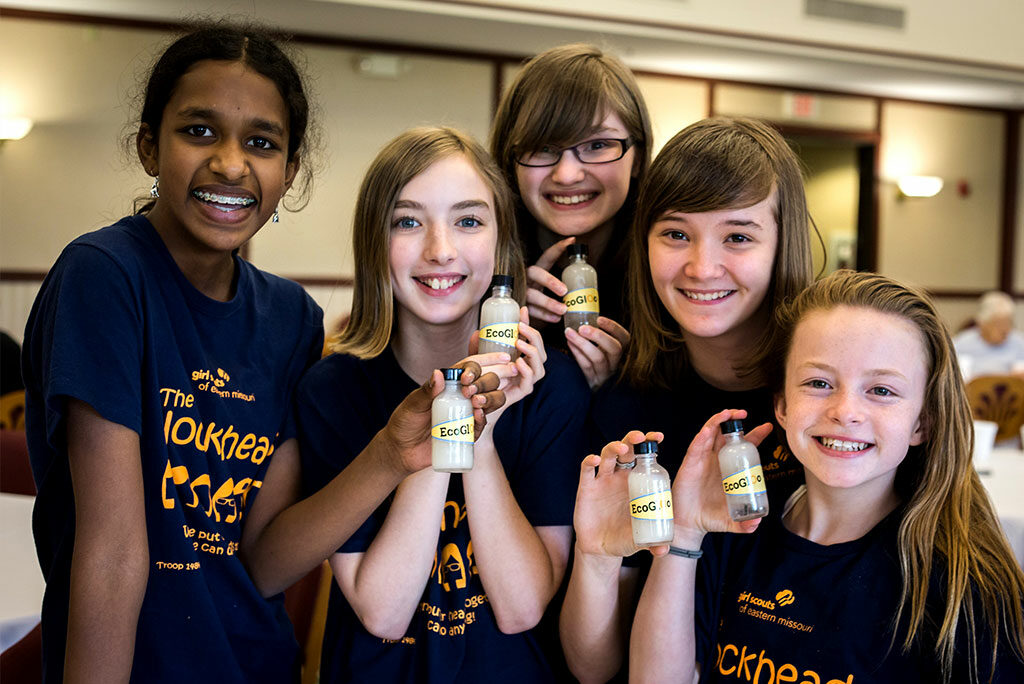 Christina Yepez, third from left, and classmates hold bottles of the glue they discovered doing an environmental project that earned an invitation to the White House Science Fair in Washington, D.C. Calling themselves the Blockheads, the budding scientists from South St. Louis County, Mo., discovered an innovative way to turn Styrofoam cups that clog landfills into a useful glue. (Joy Lamb)