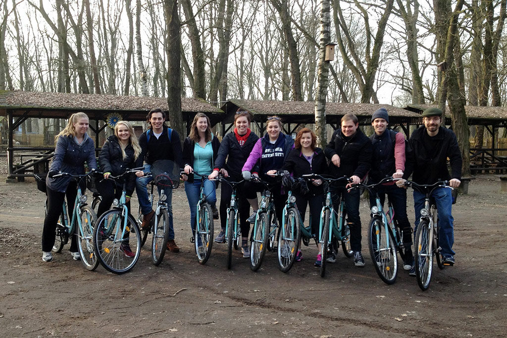 """Students in this spring's Concordia University System study-abroad program take a break from a bike tour of Wittenberg, Germany, including some """"off the beaten path"""" sites. (Courtesy of Renata Mayrhofer)"""