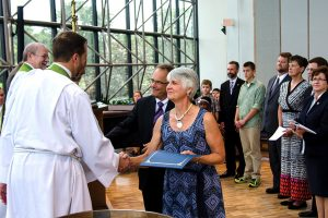 Dr. Martin and Marie Dicke, right, are congratulated by LCMS Office of International Mission staff during the June 24 Service of Sending for new overseas missionaries. The Dickes will serve as musicians/educators in Papua New Guinea. (LCMS/Frank Kohn)