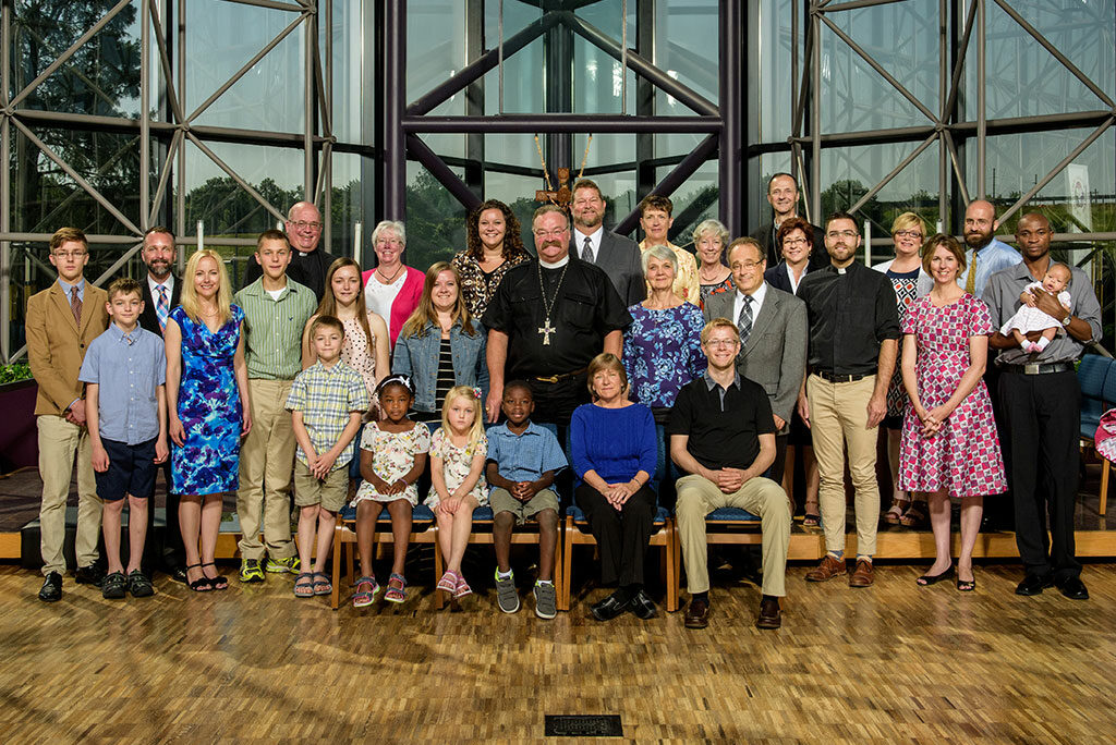 New overseas missionaries — who will be serving in 11 countries — pose for a group photo with LCMS President Rev. Dr. Matthew C. Harrison, center, during the June 13-24 orientation at the Synod's International Center in St. Louis. (LCMS/Erik M. Lunsford)
