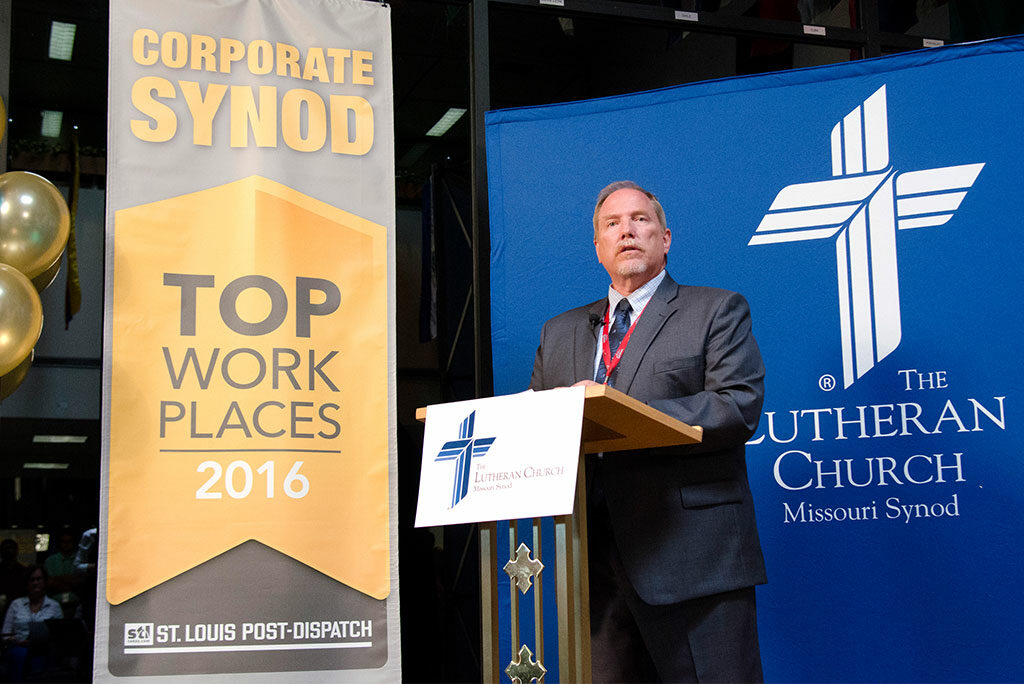 """Ronald P. Schultz, chief administrative officer of the LCMS, announces to employees June 23 at the International Center that the Synod has been recognized as a """"Top Workplace"""" by the St. Louis Post-Dispatch. The Synod, he said, has made """"a concerted effort over the past few years to put programs in place that equip and encourage organizational and employee development. We are gratified to know that it was our employees themselves — their opinions of their own workplace — that made the recognition possible."""" (LCMS/Frank Kohn)"""