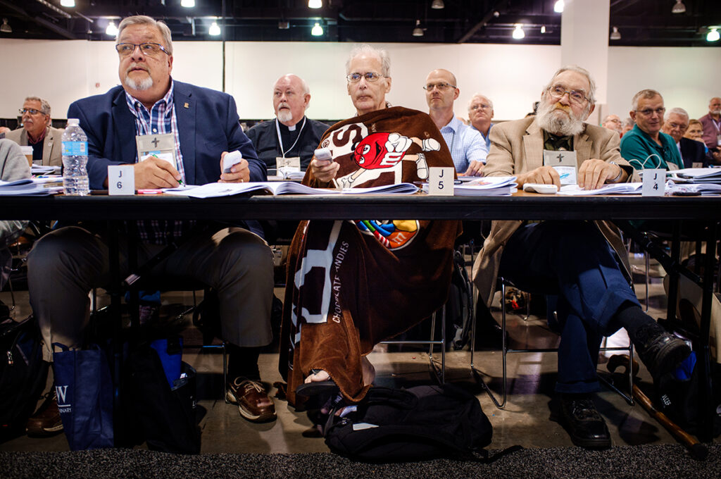 Bill Carney, voting delegate from the California—Nevada—Hawaii District, warms up with a blanket during elections at the 66th Regular Convention of The Lutheran Church—Missouri Synod on Tuesday, July 12, at the Wisconsin Center in Milwaukee. (LCMS/Erik M. Lunsford)