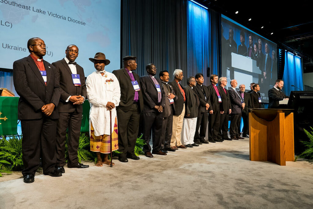 Participating in a special recognition of the LCMS' growing partnerships with churches around the world are, from left, the Rev. Amos Bolay (Evangelical Lutheran Church in Liberia), the Most Rev. Christian Ekong (Lutheran Church of Nigeria), the Rev. Modise Maragelo (Lutheran Church in Southern Africa), Rev. S. Rajagambeeram (India Evangelical Lutheran Church), Rev. Dr. J. Samuel (India Evangelical Lutheran Church), Rev. Dr. D. Monikaraj (Concordia Theological Seminary, India), Rev. Tatsuomi Yoshida (Japan Lutheran Church), Rt. Rev. Janis Vanags (Evangelical Lutheran Church of Latvia), Rev. Torkild Masvie (Lutheran Church in Norway), Rev. Adalberto Hiller (Portuguese Evangelical Lutheran Church) and Rt. Rev. Arri Kugappi (Evangelical Lutheran Church of Ingria in Russia). (LCMS/Michael Schuermann)