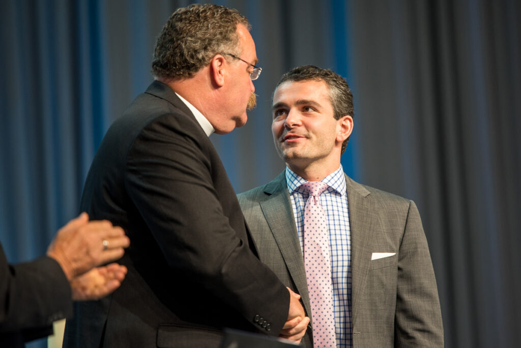 """The Rev. Dr. Matthew C. Harrison, president of the LCMS, greets Dr. Ryan Anderson, author of the book """"Truth Overruled: The Future of Marriage and Religious Liberty,"""" after Anderson spoke on Monday, July 11, 2016, at the 66th Regular Convention of The Lutheran Church–Missouri Synod in Milwaukee. (LCMS/Frank Kohn)"""