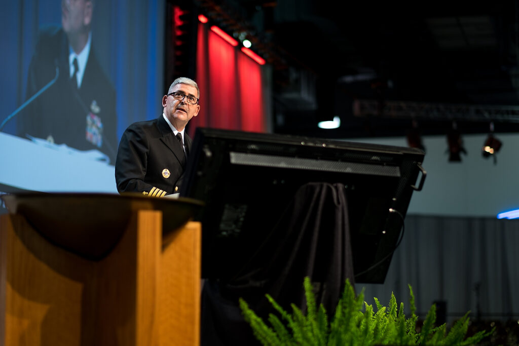 Capt. Gregory N. Todd, a chaplain for the U.S. Coast Guard, presents a resolution for Floor Committee 2 on International Witness during the July 12 session of the Synod's 66th Regular Convention in Milwaukee. (LCMS/Michael Schuermann)