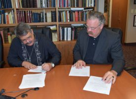 Pres. Antonio Reyes and Pres. Matthew Harrison sign the protocol agreement.