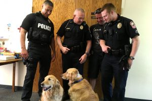 Joplin, Mo., police officers who responded to the Aug. 13 shooting there visit Immanuel Lutheran Church to receive the thanks of members involved in the congregation's comfort dog ministry and to check on the recovery of the two dogs wounded in the shooting. (Immanuel Lutheran Church)