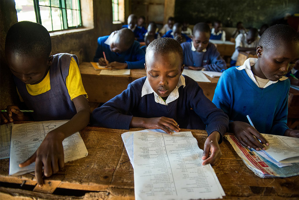 """Students at a Project24 school in Chepareria, Kenya, prepare for exams on June 23. A new LCMS """"crowdfunding"""" project aims to provide computers for Project24 students at the school. (LCMS/Erik M. Lunsford)"""