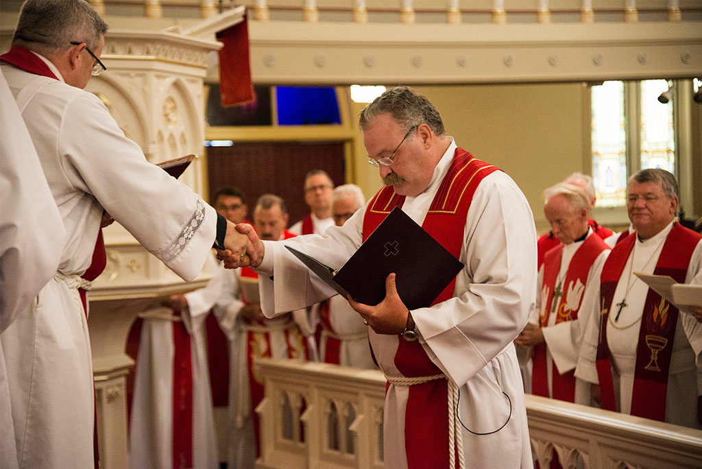 LCMS President Rev. Dr. Matthew C. Harrison shakes hands with Missouri District President Rev. Dr. R. Lee Hagan, as Harrison is installed to be Synod president for the next triennium. Harrison was elected to a third, three-year term as LCMS president earlier this year.