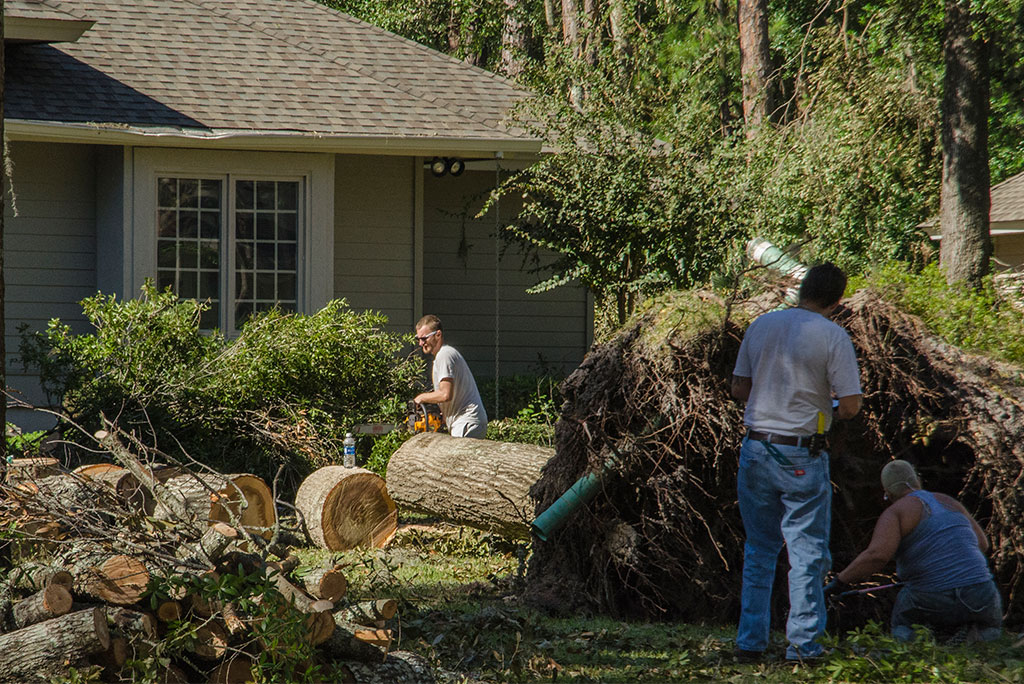 Local residents work to remove a downed tree from a South Carolina home in the aftermath of Hurricane Matthew. North Carolina and South Carolina took on torrents of rain and fierce winds as the hurricane moved up the southeastern U.S. coastline. (LCMS Communications/Al Dowbnia)