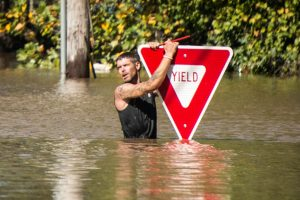 hurricane-matthew-man-and-yield-sign-1024x684
