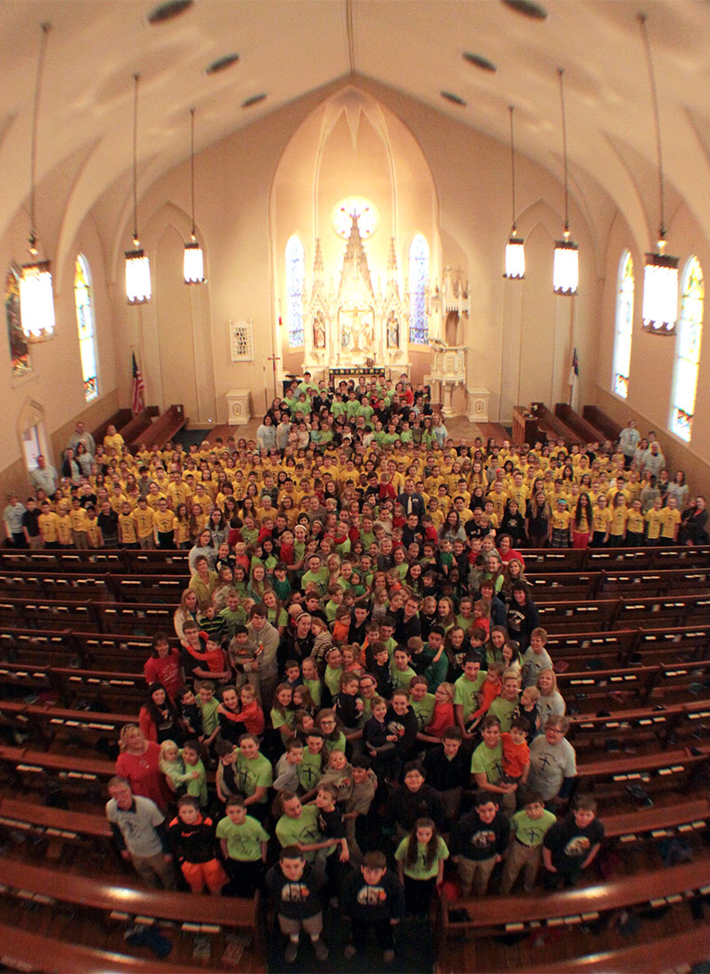 The student body at Immanuel Lutheran School, St. Charles, Mo., form a cross for a photograph in Immanuel Lutheran Church's sanctuary. (Immanuel Lutheran School)