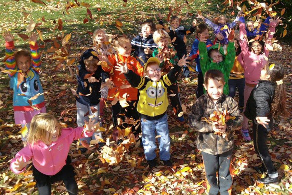 Younger students at St. Paul Lutheran School, Mount Prospect, Ill., play in the leaves. (St. Paul Lutheran School)