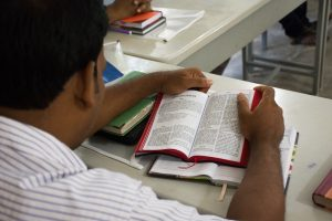 Dr. Cortright taught on Romans 1–8, pictured here in Bangla.