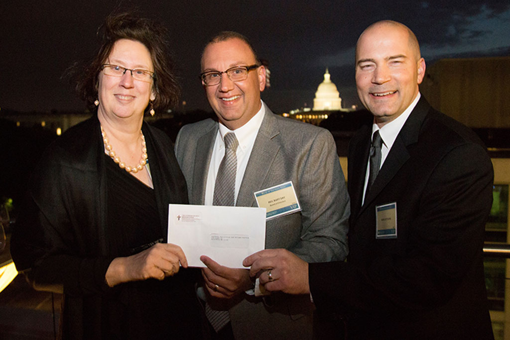 Holding the $30,000 check presented to Lutheran Immigration and Refugee Service (LIRS) at its Oct. 26 gala in Washington are (from left) LIRS CEO and President Linda Hartke, LCMS Office of National Mission Executive Director Rev. Bart Day and LCMS Youth Ministry Director Rev. Mark Kiessling. (LIRS/Lisa Nipp)