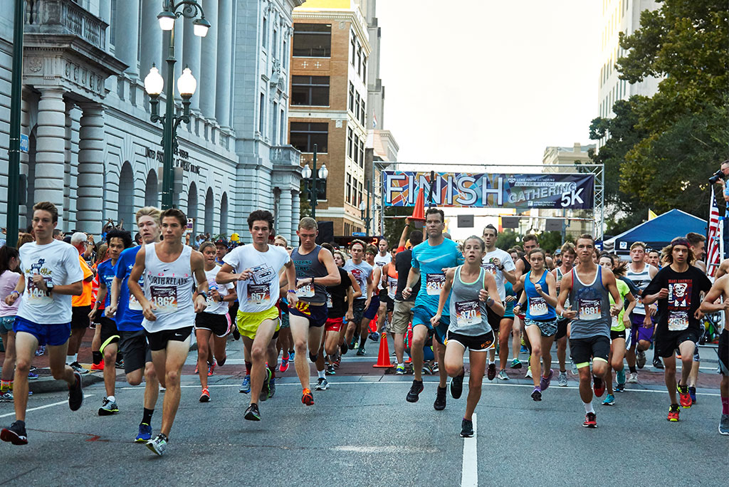"""Youth and adult participants run in downtown New Orleans during the 2016 LCMS Youth Gathering 5K on July 17. The """"Run for Welcome"""" event was sponsored by Lutheran Immigration and Refugee Service, with registration proceeds going toward its work with refugees and immigrants. (LCMS Youth Gathering/Nathan Harrmann)"""