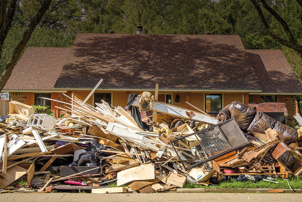 A home affected by August flooding is shrouded behind a curb full of debris Sept. 13 in Baton Rouge, La. More than 600 volunteers at Camp Restore—Baton Rouge, established with a grant from LCMS Disaster Response, have helped in the cleanup of 200-plus flood-damaged homes.