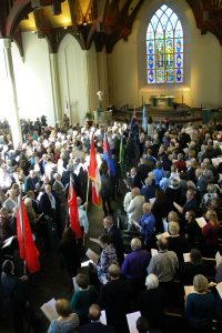 International ministry directors bearing their countries' flags process for the LHM 100th-anniversary celebration's closing worship Oct. 23 in the packed Chapel of St. Timothy and St. Titus at Concordia Seminary, St. Louis. (LCMS/Joe Isenhower Jr.)