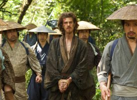 """In the new Martin Scorsese film """"Silence,"""" Andrew Garfield, center, portrays fictional Jesuit missionary Father Rodrigues, whose faith is put to the test by his Japanese captors. While it is difficult to watch, the film is a cut above other Christian films, says reviewer Ted Giese."""