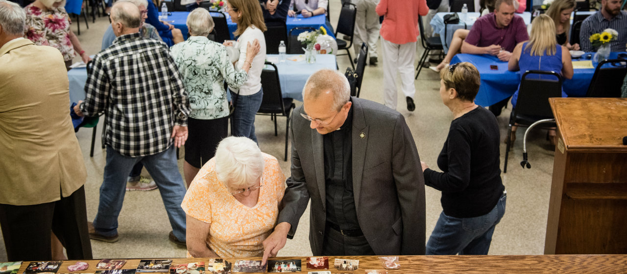The Rev. Wally Arp, senior pastor of St. Luke's Lutheran Church, visits with Beverly Kilbey at a birthday party for a 100 year-old parishioner at Lutheran Haven on Saturday, March 5, 2016, in Oviedo, Fla. LCMS Communications/Erik M. Lunsford
