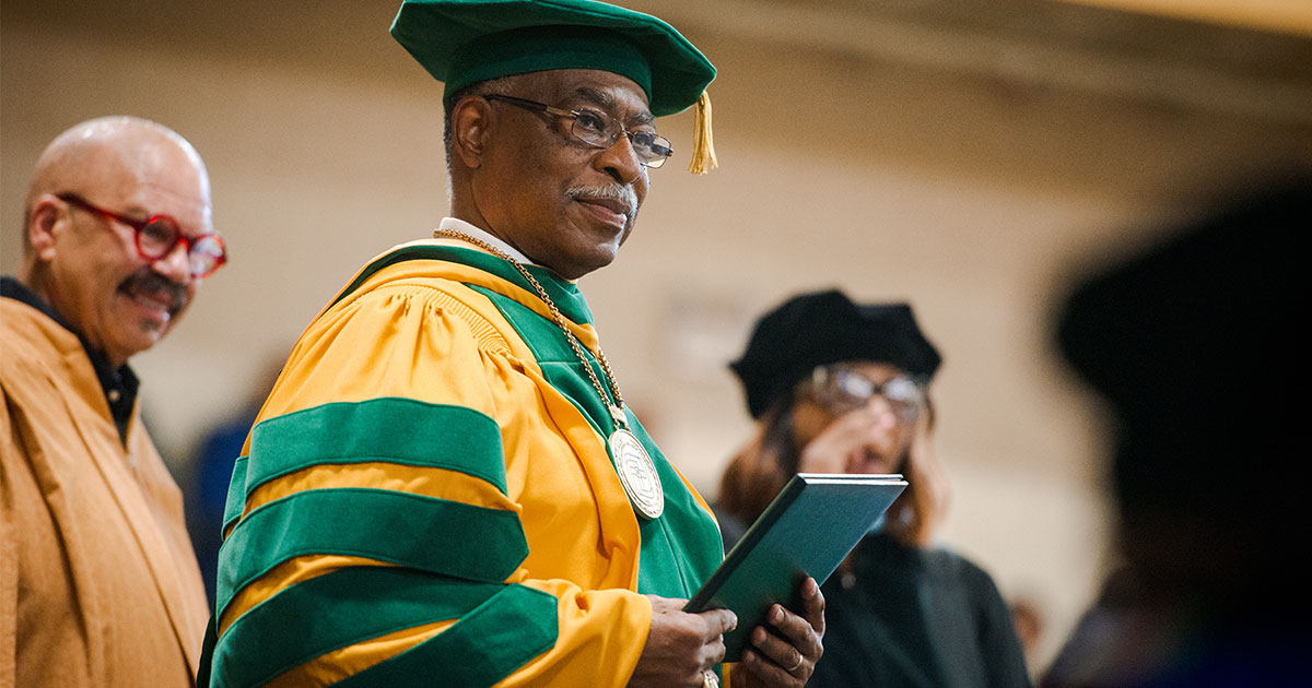 Dr. James Lyons, the transitional president at Concordia College Alabama, extends diplomas during the college's 92nd and final graduation ceremony on Saturday, April 28, in Selma, Ala. (LCMS/Erik M. Lunsford)