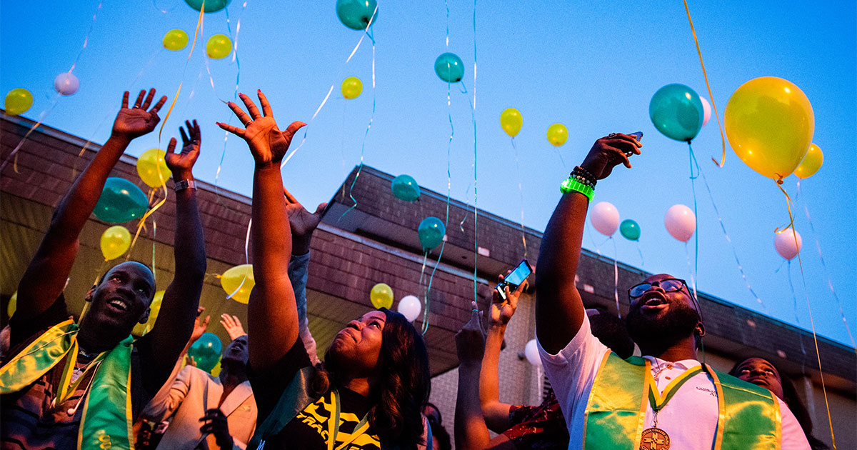 Concordia College Alabama students (from left) Wendy Thoby, Kiana Gay and Linzell Tucker release balloons on Friday, April 27, following the Legacy/Candlelight service that was held in thanksgiving for the college's 96 years of service in Selma, Ala. (LCMS/Erik M. Lunsford)