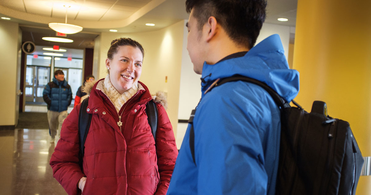 LCMS national missionary Rebecca Wagner talks with Juncheng, a Chinese student studying philosophy, on Feb. 21, 2018, at the University of Minnesota in Minneapolis. Wagner serves alongside the Rev. David Kind at University Lutheran Chapel and focuses on outreach to international students. (LCMS/Erik M. Lunsford)